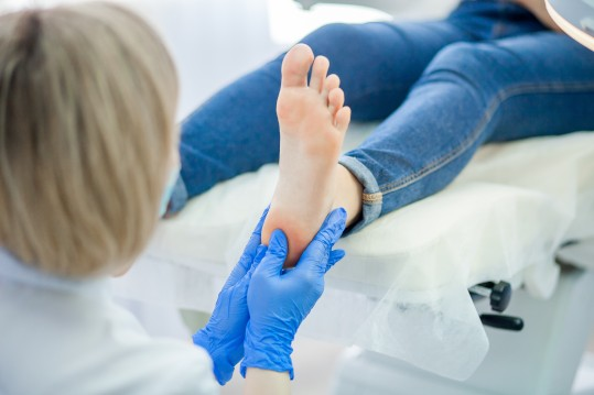 Southern Podiatry Nowra Podiatrist cutting toe nails and assessing foot pain
